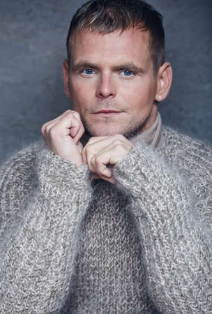 freezed: Freezed man in warm wool sweater.