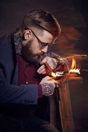 Bearded man smocking cigar. Stock Photo