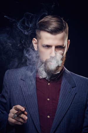 cigare: Bearded fashionable man in sunglasses smoking cigar. Stock Photo