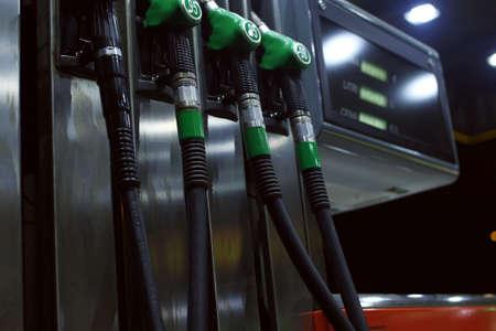 gasolinera: Diferentes pistolas de gas diesel. Foto de archivo