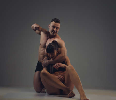 unrecognisable people: Domestic violence. Nude man hitting a woman. Stock Photo