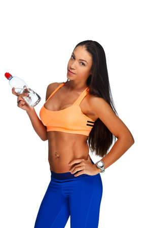 the caucasian beauty: Athletic fitness woman in sportswear holding bottle with water. Isolated on a white background. Stock Photo