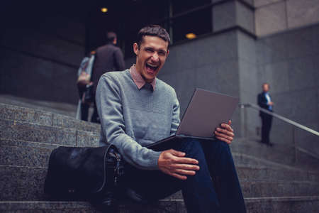 interactivity: Shouting man using laptop.