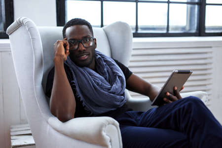 blackman: Blackman in eyeglasses working with table pc. Stock Photo