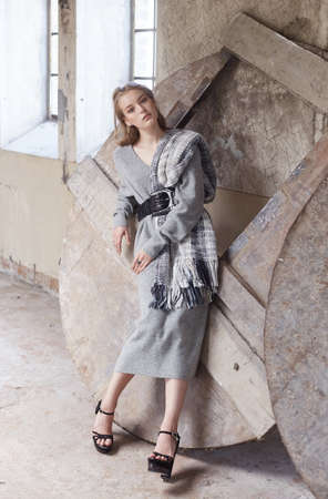 fall winter: Modern woman in a grey dress.
