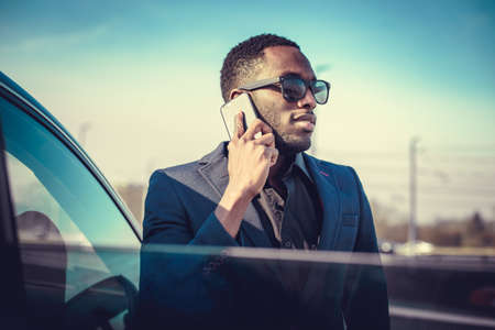 African american businessman in a suit speaking on smartphone.