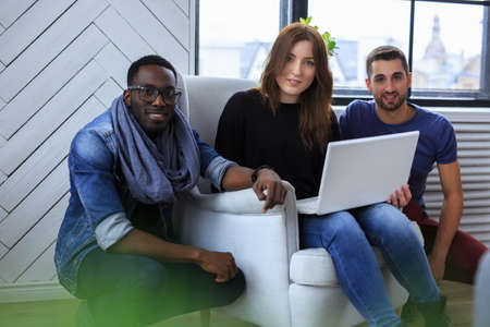 blackman: International group of people working with laptop.