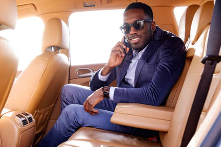 blackman: Blackman in a suit in the car.