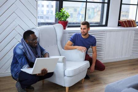 blackman: Blackman and white guy warking with laptop.