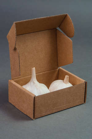 two pieces: Two pieces of garlic in the box.