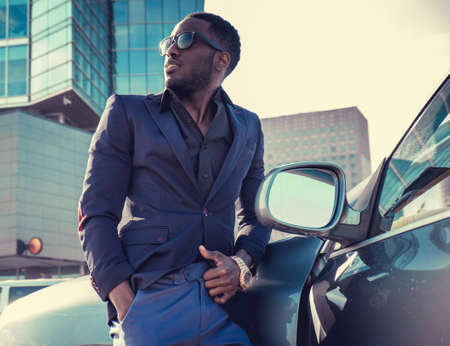 blackman: Casual african american man posing near the car. Stock Photo