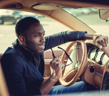 blackman: Casual black man in the car.