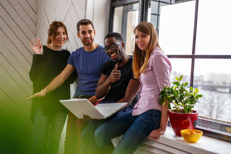 blackman: Group of international students using laptop. Stock Photo