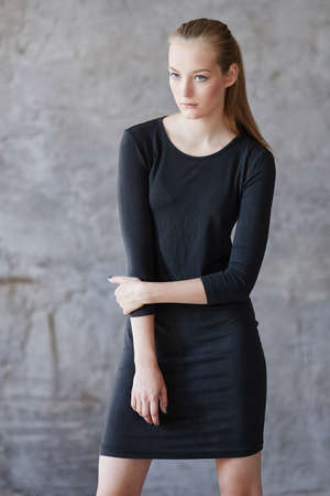 blondy: Blondy young woman in a black dress.