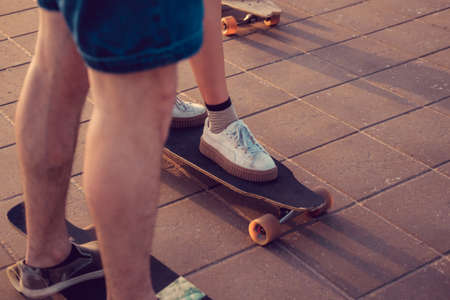 skaters: Skaters legs on longboards. Stock Photo