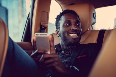 blackman: Casual afro american male in a car. Stock Photo