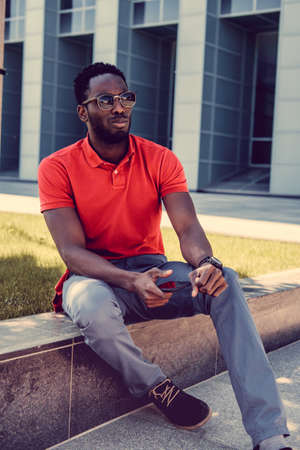 red tshirt: Portrait of smiling casual black man in red tshirt. Stock Photo