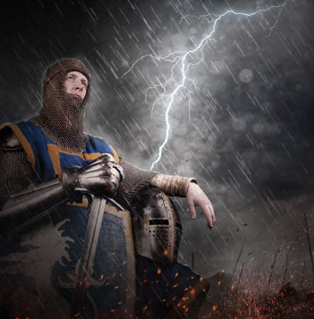 battlefield: Lightning strikes a knight on battlefield. Stock Photo