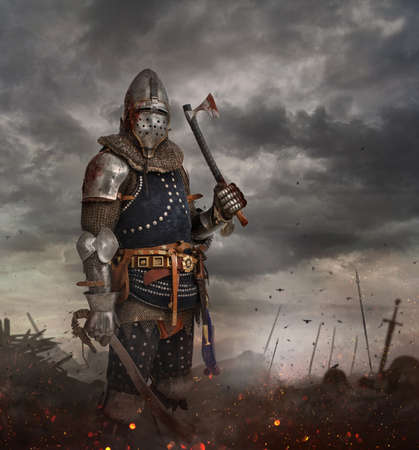 Knight with sword in battlefield with dark clouds on background. Standard-Bild