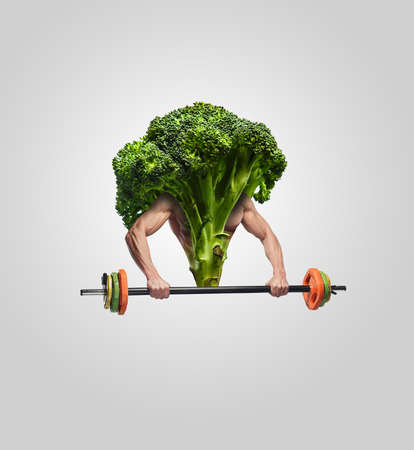 mans: Broccoli with muscular mans hands and barbell.
