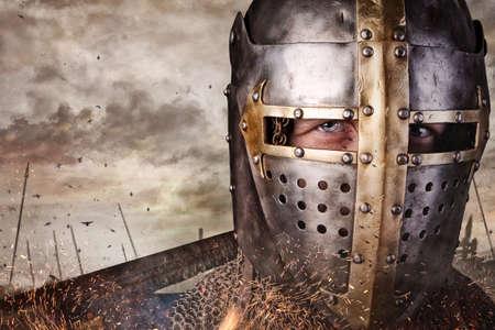 sword fight: Close up portrait of a man in knight helmet.