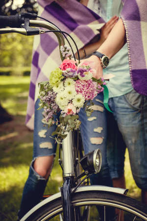 handlebar: Colorful flowers bouquet on bicycle handlebar. Stock Photo