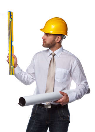 executive helmet: Worker male in yellow safety helmet holding industry level and drawning tube. Stock Photo