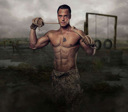 swampland: Shirtless muscular soldier in a training swampland.