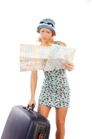 map case: Portrait of slim blond woman with travel case and a map isolated on a white background.