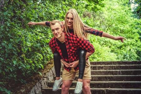 Loving couple having fun in a wild summer park.