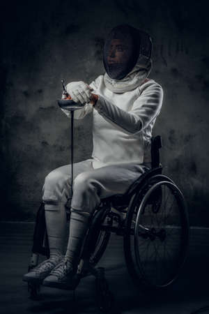 Portrait of female paralympic wheelchair fencer.