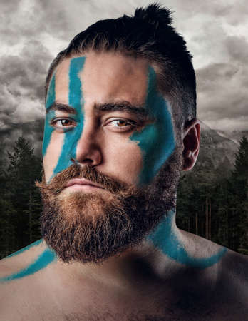Portrait of bearded Scandinavian male over nature, landscape background. Stock Photo