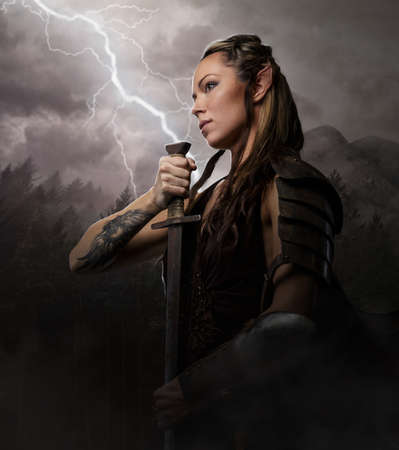 body paint sexy: Female elf woman warrior holding sword on lightning background.