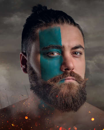 battlefield: Artistic close up portrait of Scandinavian male warrior on a battlefield. Stock Photo