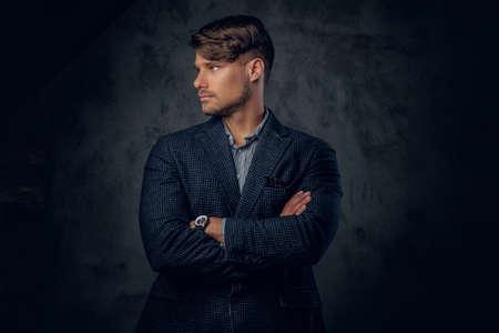 glance: Studio portrait of modern, stylish male on glance grey background.