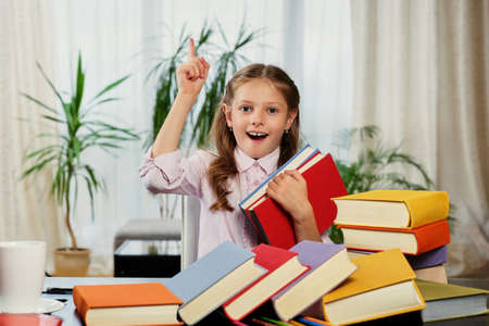 idealistic: Positive little girl likes reading a lot of books.