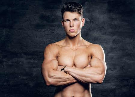 glare: Glare portrait of shirtless athletic young male on grey background.