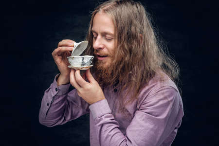 enjoing: Positive bearded male enjoing Chinese tea.