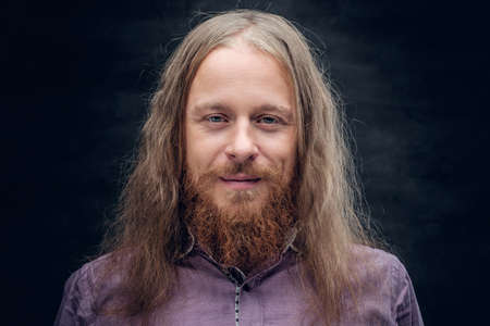 Close up portrait of bearded male with long hair.