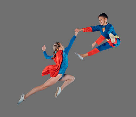 cloak: Jumping and flying kids in super human costume isolated on grey background. Stock Photo