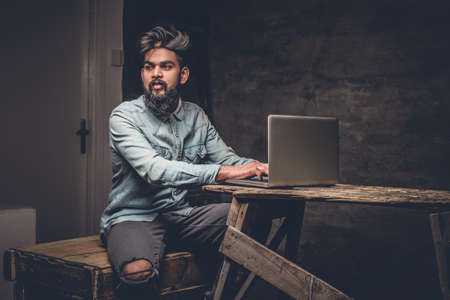 uniformity: Stylish bearded Indian male working with laptop. Stock Photo