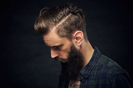 uniformity: Portrait of bearded male with long hair. Stock Photo