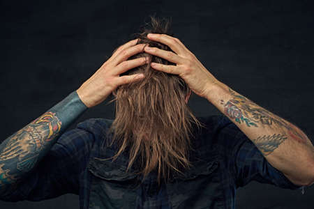 Portrait of bearded male with long hair. Stock Photo
