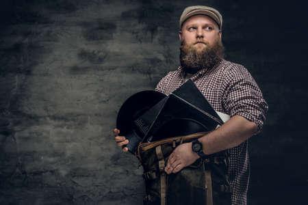 throttle: Fat bearded hipster man holds vinyl records.