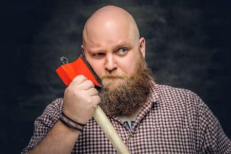 Fat bald, bearded man holds an axe.