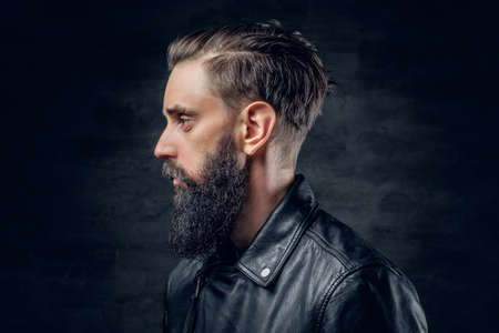 uniformity: Close up portrait of bearded male wearing black leather jacket.