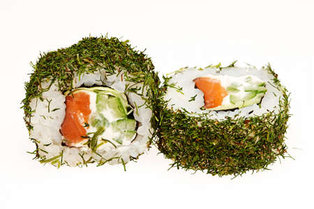 pastes: Different types of roll sushi on a plate isolated on white background.