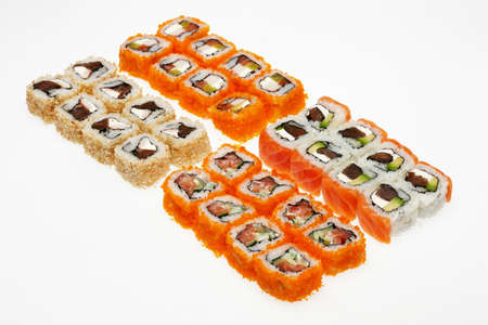 Different types of roll sushi on a plate isolated on white background.
