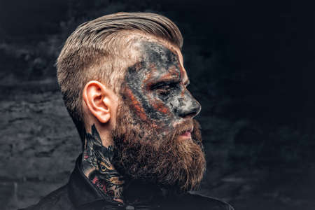 Portrait of a scary bearded male with burning make. Stock Photo
