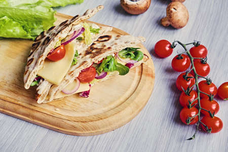 Delicious pita bread with ham, cucumber and tomatoes.
